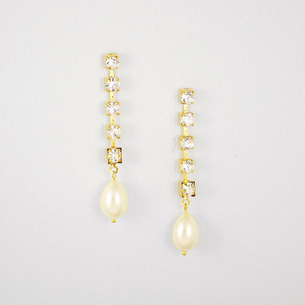 Gold Juno Bohemian Pearl Drop Earrings on grey