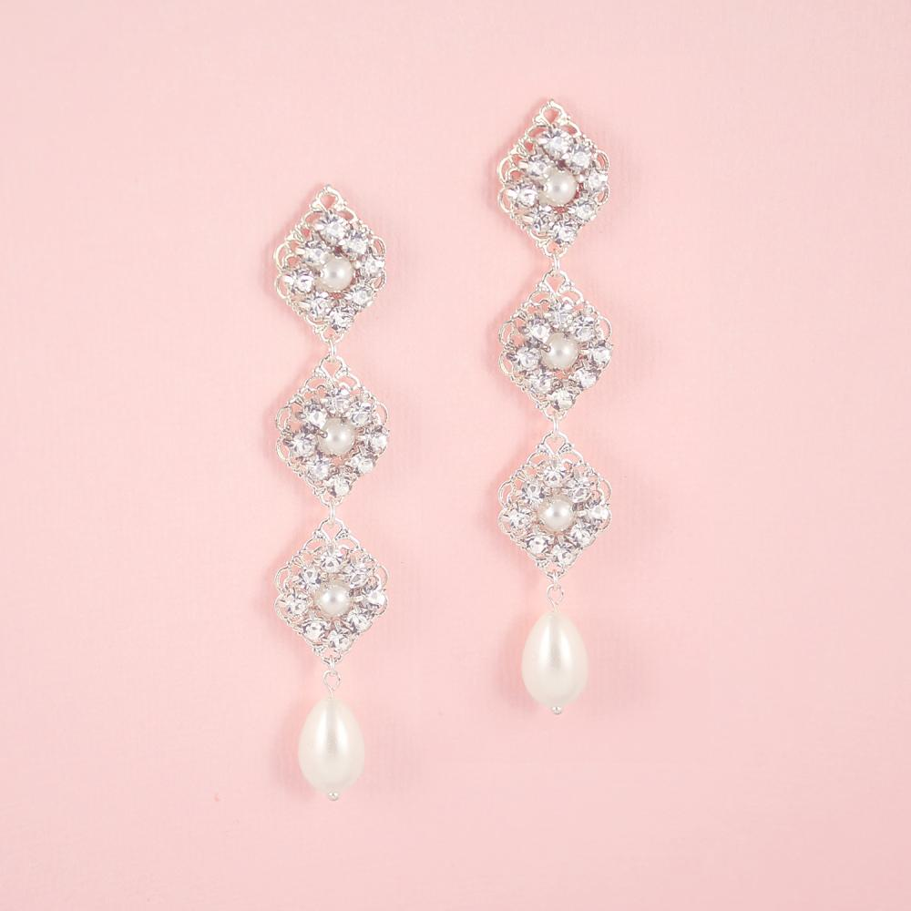 Silver Kaya Bridal Pearl Drop Earrings on pink