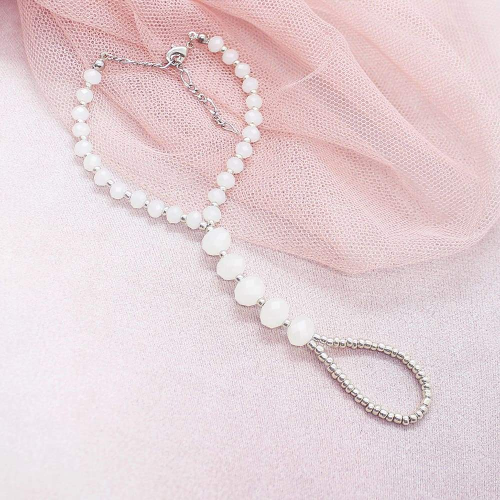 White Kelana Bohemian Bracelet Ring on pink