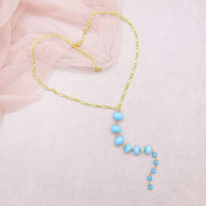 Turquoise Kelana Bohemian Backdrop Necklace on pink