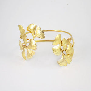 Gold Kiko Gingko Leaf Cuff Bracelet on grey