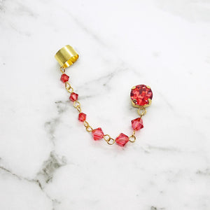 Coral Kira Crystal Ear Climber on white