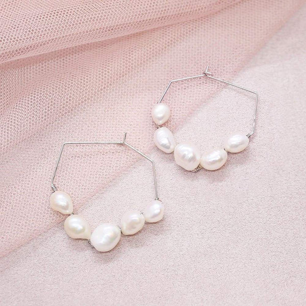 Kygo freshwater pearl geo earrings on pink