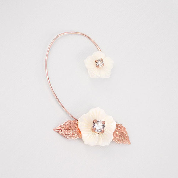 Rose gold Leilani Statement Floral Ear Climber on grey