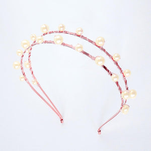Rose gold Lulu Double Pearl Bridal Headband on grey