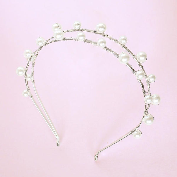 Silver Lulu Double Pearl Bridal Headband on pink