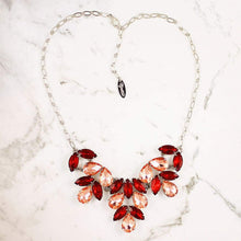 Load image into Gallery viewer, Red & pink Marilyn Crystal Statement Necklaceon on grey