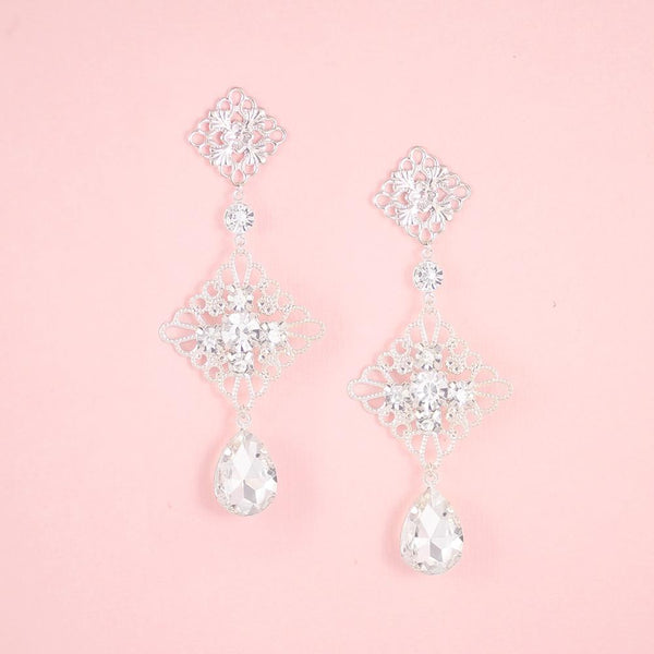 Silver Nicola Boho Chandelier Bridal Earrings on pink