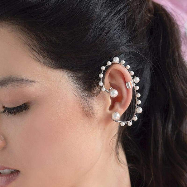 Off-white Ora Pearl Ear Climber on left ear