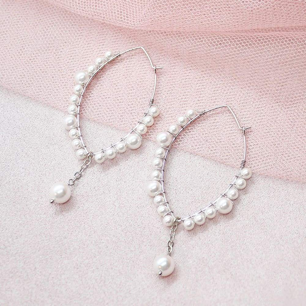 Off-white Ora Pearl Hoop Earrings on pink