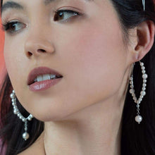 Load image into Gallery viewer, Left & right Off-white Ora Pearl Hoop Earrings from front