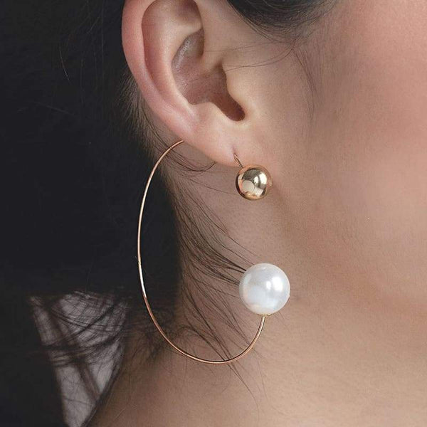 Rae Large Hoop and Pearl Ball Earrings on right ear