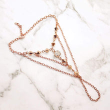Load image into Gallery viewer, Rose gold Ryda bohemian hand chain on grey