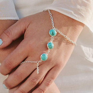Skye Turquoise Hand Chain on left hand
