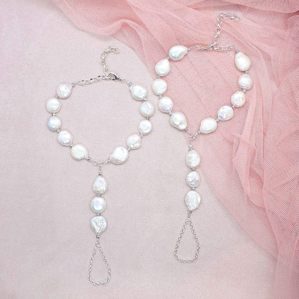 White Sloan Freshwater Pearl Barefoot Sandals on pink