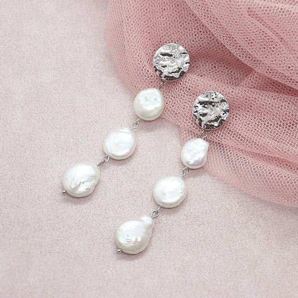White Sloan Freshwater Pearl Earrings on pink
