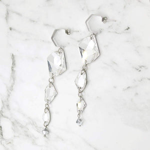 Sza Modern Glam Crystal Earrings on grey