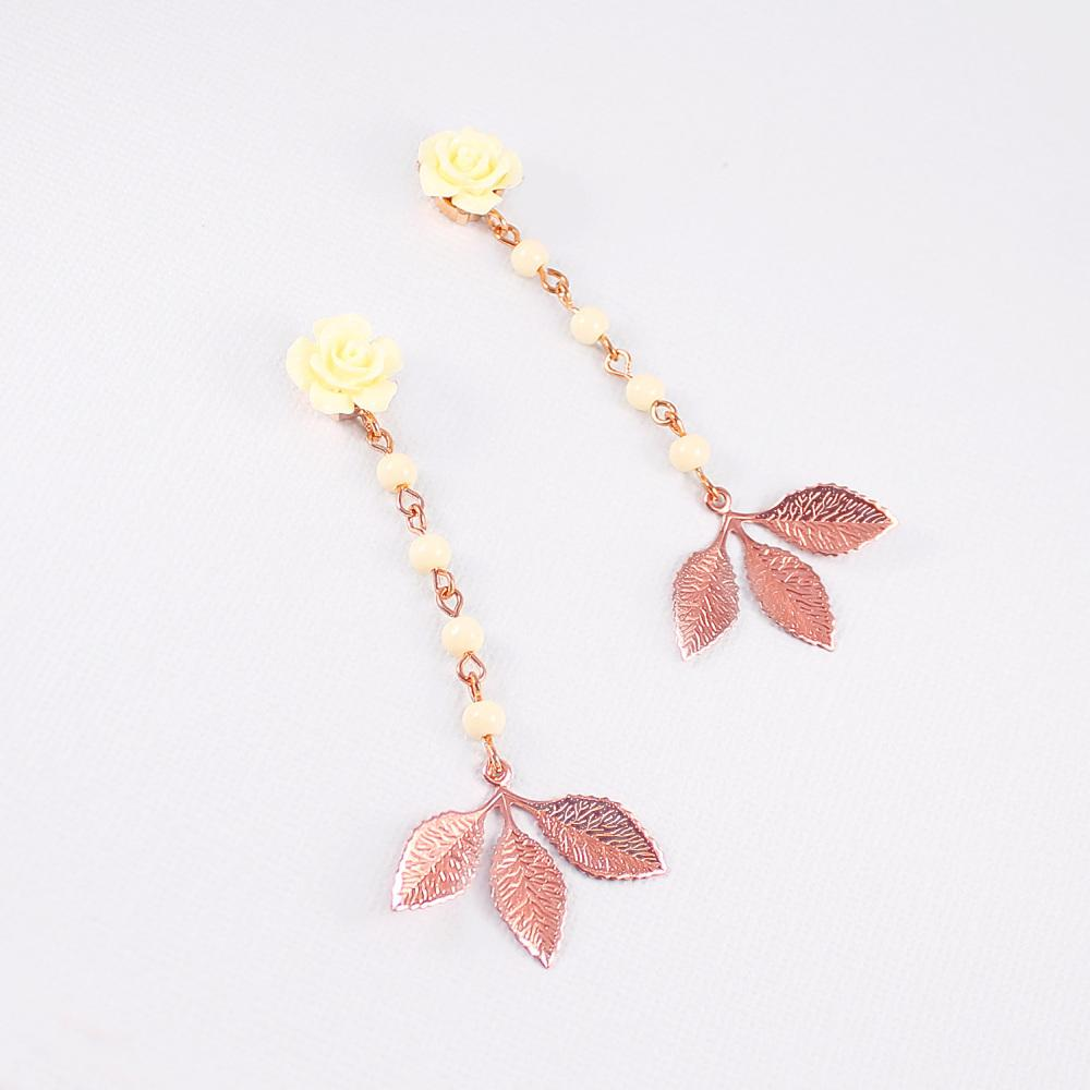 Rose gold Thea Leaf Earrings on grey