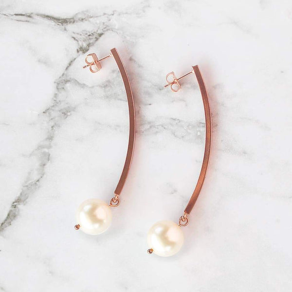 Rose Gold with Ivory Virgo Long Bar Pearl Earrings on grey
