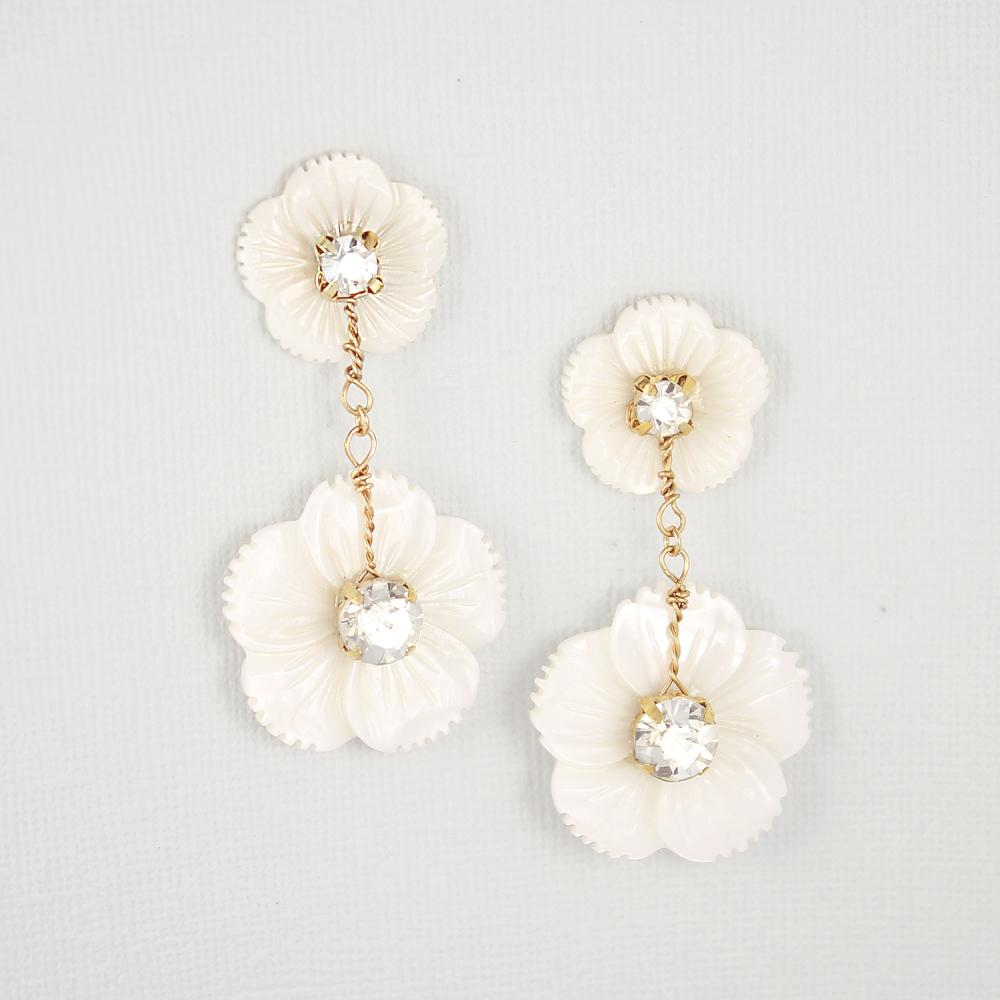 Gold Wanika Tropical Flower Bridal Earrings on grey