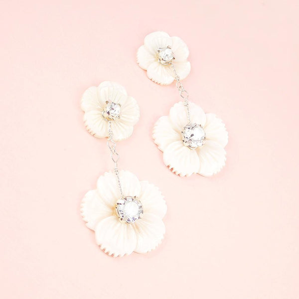 Silver Wanika Tropical Flower Bridal Earrings on pink