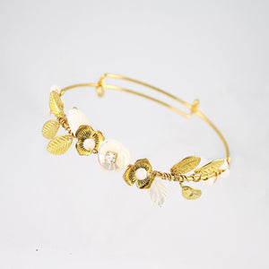 Gold Willa Flower Bridal Bracelet on grey