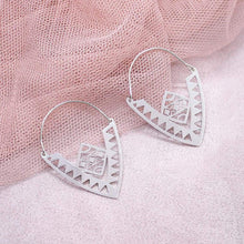 Load image into Gallery viewer, Xylo Tribal Earrings on pink