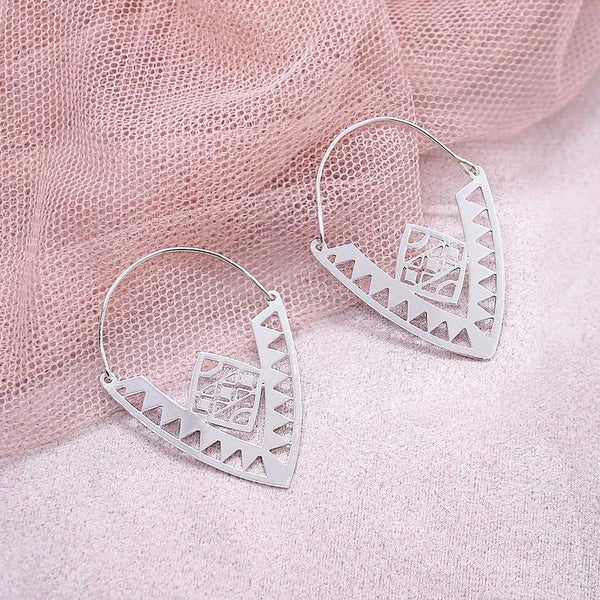 Xylo Tribal Earrings on pink