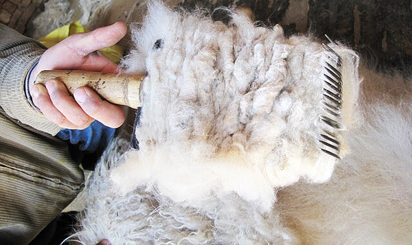 why is cashmere so expensive blog combing cashmere fibres by seahorse silks
