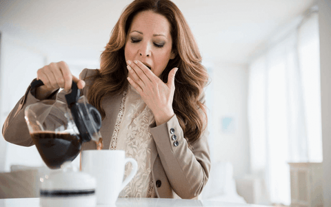 pouring morning coffee and yawning