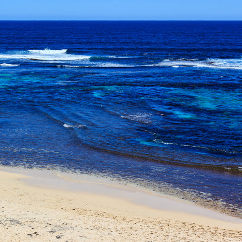 Prussian blue ocean at surfers point Margaret river