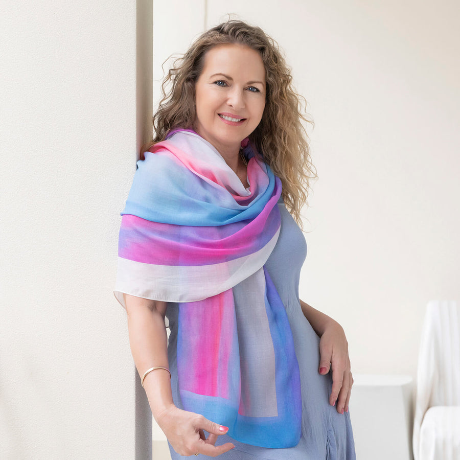 g & t time pink & blue scarf worn as wrap over blue dress by seahorse silks