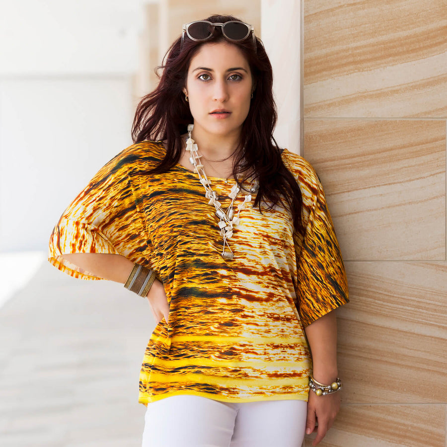 midas touch gold silk jersey top worn with white capris