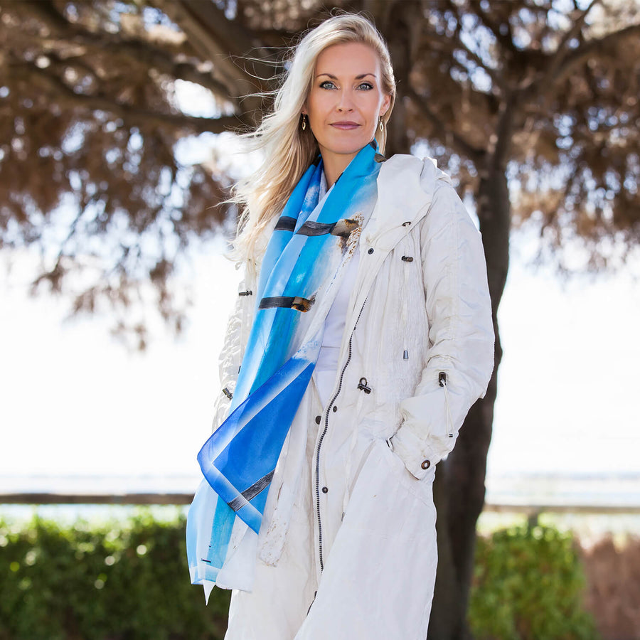 poles oblong blue silk scarf worn with white coat