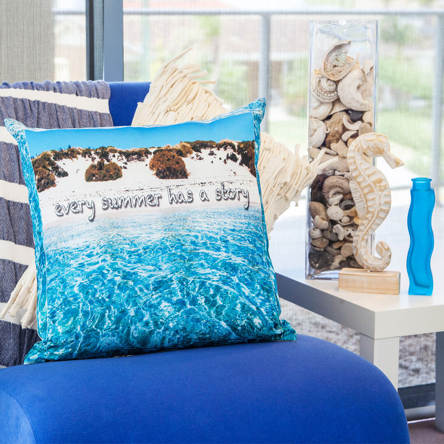 summer story square linen photo cushion on blue chair