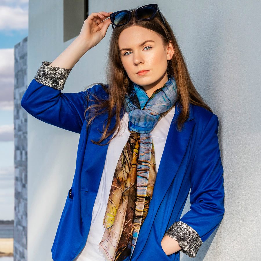 the dam wool cashmere scarf with blue jacket by seahorse silks