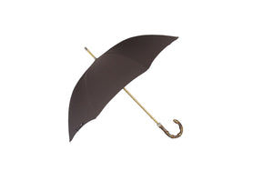 The Classic Whangee handle and canopy has an east meets west style, reminiscent of the once colonial Burmese capital. Classic hand made Umbrella. manufactured in London, England.  Plain canopy with Whangee handle with oak stained beechwood shaft.  Nickel