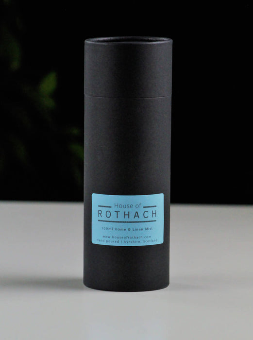 Matt black gift tube made with recycled card with blue label on front and House of Rothach label on lid.