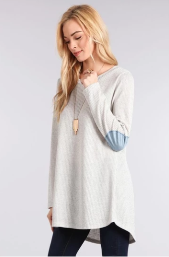 A Knit Sweater From An Online Boutiques Store