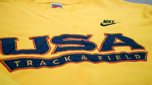 NIKE 90'S PREMIUM USA EMBROIDERED CREW - GOLDEN