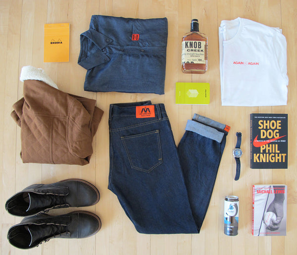 assortment of again&again products like jeans, denim shirts, and tee shirts along with our favorite other brands.  Items include leather boots, a Pendleton jacket, Farer watch, Knob Creek Whiskey, Caribou Coffee, and a few books.