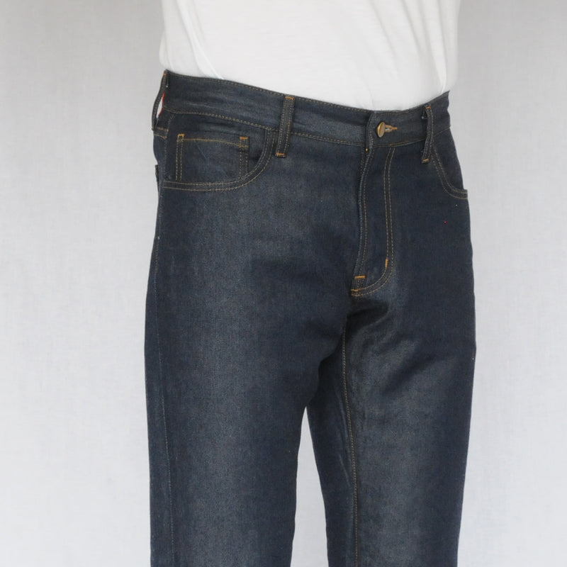 close up on model image of front of again&again dark wash, slim-fit jeans. Model is wearing a white shirt.