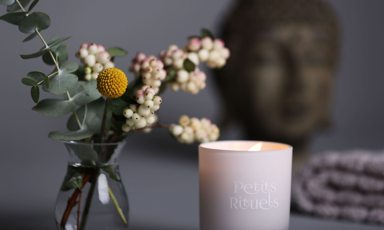buddha-head-candle-flowers