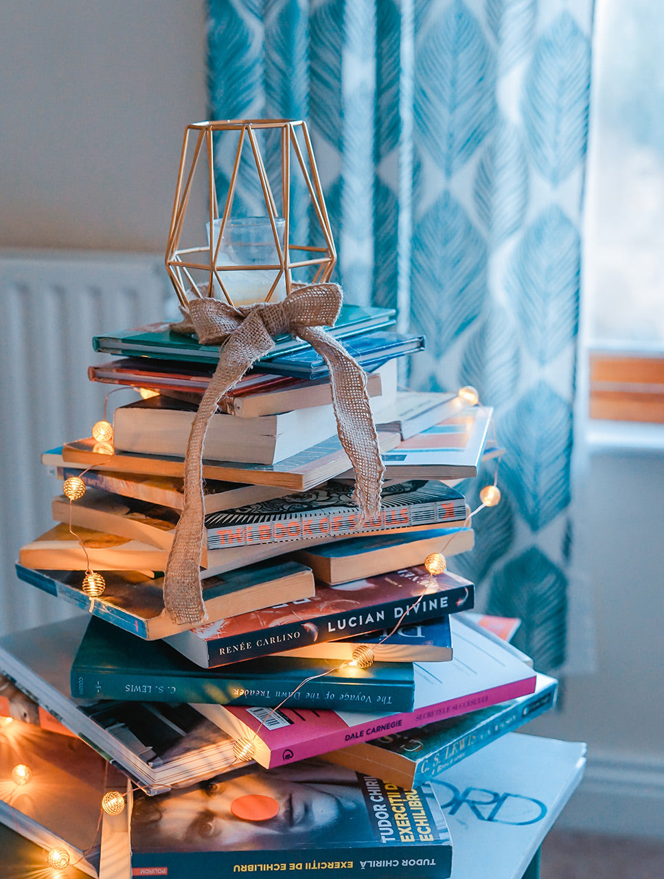 Pile of reading books in cosy room.