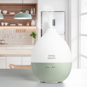 Ultrasonic diffuser with a green base and white top.