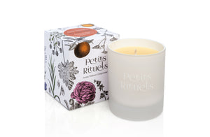 Petits Rituels organic Christmas candle outside its packaging.