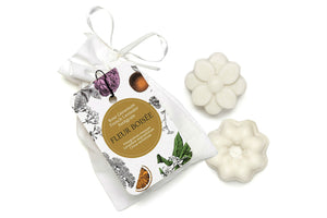Petitgrain essential oil wax melts in a small white cotton bag.