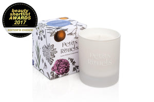 Lavender scented candle in luxury white glass and floral packaging.
