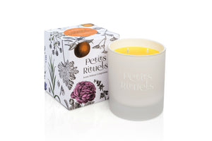 Orange Scented Candle with floral packaging.