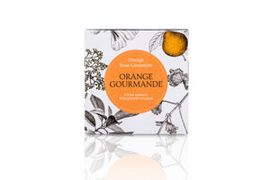 Floral packaging of orange scented candle.